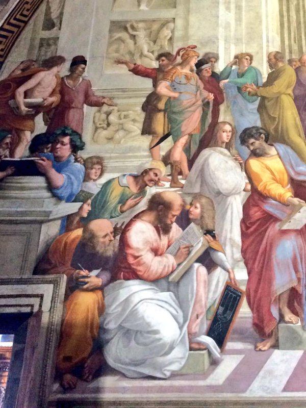 School of Athens, detail. Averroes (turban, green cloak) looks over the shoulder of Pythagoras (pink cloak, large book)